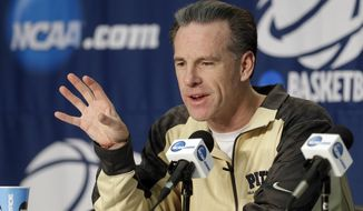 Pittsburgh head coach Jamie Dixon answers questions at a news conference for the NCAA college basketball tournament in Orlando, Fla., Wednesday, March 19, 2014. Colorado plays against Pittsburgh in a second round game on Thursday. (AP Photo/John Raoux)