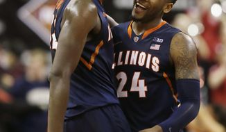 Illinois guard Rayvonte Rice (24) and Illinois forward Nnanna Egwu (32) smile as they celebrate after their NCAA mens NIT college basketball game against Boston University in Boston, Wednesday, March 19, 2014. Illinois defeated Boston University 66-62 in a come-from-behind victory late in the second half advancing to the second round of the NIT Tournament. (AP Photo/Stephan Savoia)