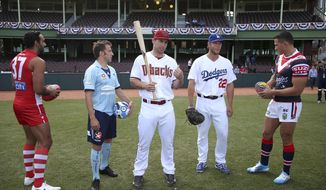 The Los Angeles Dodgers' Clayton Kershaw, second right, and Arizona Diamondbacks' Paul Goldschmidt, center, meet local sporting stars, Adam Goodes from Australian rules Football, left, soccer player Alessandro Del Piero, second left, and rugby league player Sonny Bill Williams, right, at the Sydney Cricket Ground in Sydney, Wednesday, March 19, 2014. The MLB season-opening two-game series between the Dodgers and Diamondbacks in Sydney will be played this weekend. (AP Photo/Rick Rycroft)