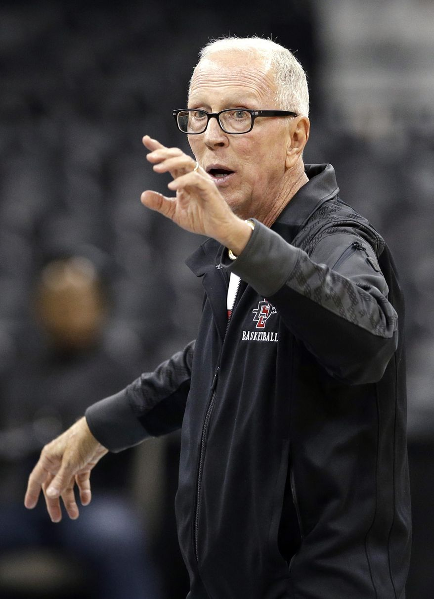 San Diego State head coach Steve Fisher directs his team during practice for the NCAA college basketball tournament in Spokane, Wash., Wednesday, March 19, 2014. San Diego State plays against New Mexico State in a second-round game on Thursday. (AP Photo/Elaine Thompson)