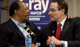 Former D.C. Mayor and current City Council member Marion Barry, left, embraces Mayor Vincent C. Gray during a media availability on Wednesday, where Mr. Barry announced he would endorse Mr. Gray's bid for re-election. (associated press)