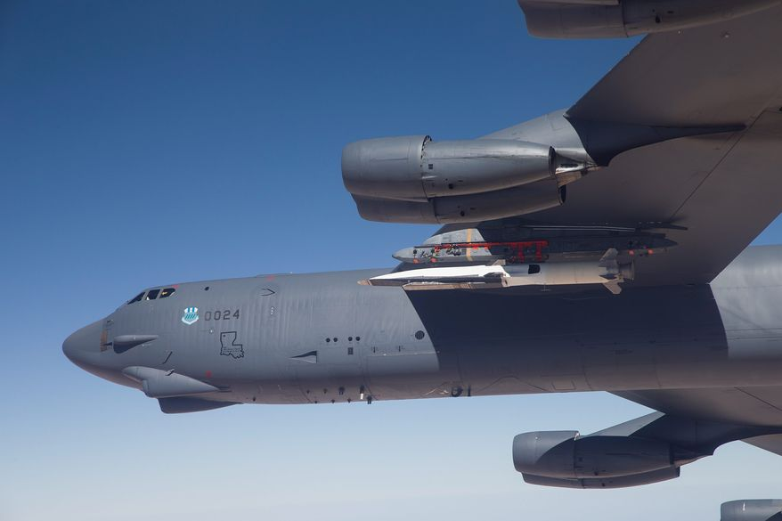 The X-51A Waverider, carried under the wing of a B-52H Stratofortress bomber,  prepares to launch the fourth and final flight over the Pacific Ocean. The X-51A, an experimental, unmanned aircraft, went hypersonic during a test off the Southern California coast, traveling at more than 3,000 mph, the Air Force said Friday. (U.S. Air Force)