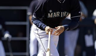 Seattle Mariners' Brad Miller hits a triple during the third inning of a spring exhibition baseball game against the Milwaukee Brewers, Wednesday, March 19, 2014, in Peoria, Ariz. (AP Photo/Darron Cummings)
