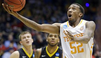Tennessee guard Jordan McRae (52) drives against Iowa in the first half of a first-round game of the NCAA college basketball tournament on Wednesday, March 19, 2014, in Dayton, Ohio. (AP Photo/Al Behrman)
