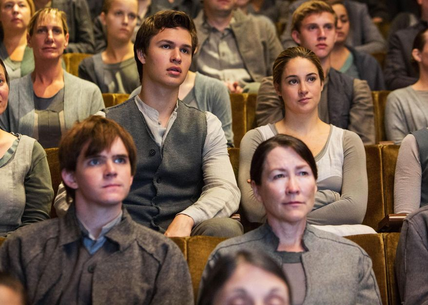 "This photo released by Summit Entertainment, LLC shows Ansel Elgort, center, left, as Caleb Prior and Shailene Woodley, center, right, as Beatrice ""Tris"" Prior, right, in the film, ""Divergent."" (AP Photo/Summit Entertainment, Jaap Buitendijk)"