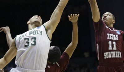Texas Southern guard Lawrence Johnson-Danner (11) and Cal Poly forward Chris Eversley (33) go for a rebound in the first half of a first-round game of the NCAA college basketball tournament on Wednesday, March 19, 2014, in Dayton, Ohio. (AP Photo/Al Behrman)