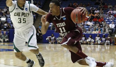 Texas Southern guard Lawrence Johnson-Danner (11) drives against Cal Poly guard Kyle Odister (35) in the first half of a first-round game of the NCAA college basketball tournament on Wednesday, March 19, 2014, in Dayton, Ohio. (AP Photo/Skip Peterson)