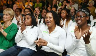 Baylor head coach Kim Mulkey, left,  Niya Johnson,  Odyssey Sims,  Sune Agbuke, right, applaud while watching the NCAA selection show,  Monday, March 17, 2014, in Waco, Texas. (AP Photo/Waco Tribune Herald, Rod Aydelotte)