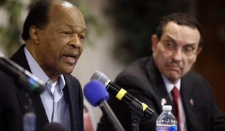 Former Mayor and current DC City Council member Marion Barry, left, speaks as Mayor Vincent Gray listens during a media availability to announce Barry's endorsement of Gray's bid for re-election, Wednesday, March 19, 2014 in Washington. (AP Photo/Alex Brandon)