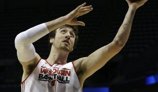 Wisconsin forward Frank Kaminsky goes up for a shot during a practice session for their NCAA college basketball tournament game Wednesday, March 19, 2014, in Milwaukee. Wisconsin plays American on Thursday, March 20, 2014. (AP Photo/Morry Gash)