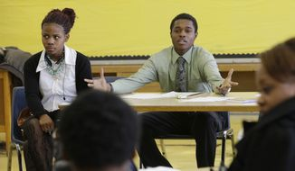 "ADVANCE FOR USE SUNDAY, MARCH 23, 2014 AND THEREAFTER - In this Feb. 27, 2014 photo, student Jalen Pickett, talks during a class that teaches anger management and conflict resolution skills at Cody High School in Detroit. Jalen, now a diligent student with aspirations to be a defense lawyer, had an inauspicious start to high school. His fighting earned him a spot in the new police department program - the Children in Trauma Intervention Camp which gives students an alternative to expulsion in the form of training and counseling from police officers and other adult mentors. ""If Detroit can change, it's up to the youth to do it,"" Jalen says. ""I feel Detroit can come back. And if I do go away to college, I plan on coming back here and giving back to Detroit."" (AP Photo/Carlos Osorio)"