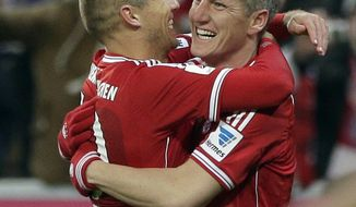 Bayern's Bastian Schweinsteiger, right, hugs teammate Bayern's Arjen Robben after scoring his side's second goal during the German first division Bundesliga soccer match between FC Bayern Munich and Bayer 04 Leverkusen, in Munich, southern Germany, Saturday, March 15, 2014. (AP Photo/Matthias Schrader)