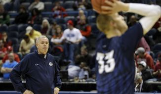 BYU head coach Dave Rose, left, watches as forward Nate Austin shoots during a practice session for their NCAA college basketball tournament game Wednesday, March 19, 2014, in Milwaukee. BYU plays Oregon on Thursday. (AP Photo/Morry Gash)
