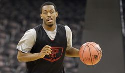 San Diego State's Xavier Thames dribbles during practice for the NCAA college basketball tournament in Spokane, Wash., Wednesday, March 19, 2014. San Diego State plays against New Mexico State in a second-round game on Thursday. (AP Photo/Elaine Thompson)