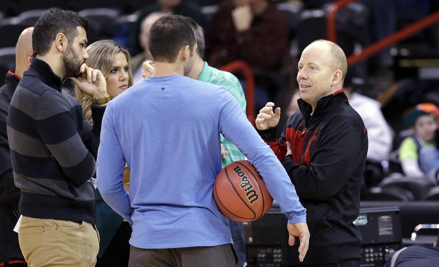Cincinnati  coach Mick Cronin, right, talks on the sidelines during practice for the NCAA college basketball tournament in Spokane, Wash., Wednesday, March 19, 2014. Cincinnati plays against Harvard in a second-round game on Thursday. (AP Photo/Elaine Thompson)