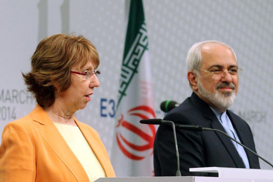 European foreign policy chief Catherine Ashton, left, and Iranian Foreign Minister Mohamad Javad Zarif, right, adress the media after closed-door nuclear talks in Vienna, Austria, Wednesday, March 19, 2014. They said the talks addressed Iran's uranium enrichment program, a nearly finished nuclear reactor and the lifting of sanctions on Iran that have been imposed successively over the past decade as Tehran expanded its atomic activities. The talks will resume April 7 in Vienna. (AP Photo/Ronald Zak)