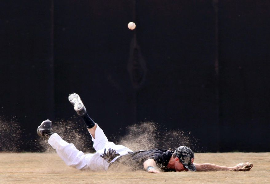 10ThingstoSeeSports - University of Texas of the Permian Basin outfielder Colin Kowal is unable to make a diving catch in the first game of a doubleheader game against Oklahoma Christian University, Friday, March 14, 2014, in Odessa, Texas. (AP Photo/Odessa American, Edyta Blaszczyk, File)