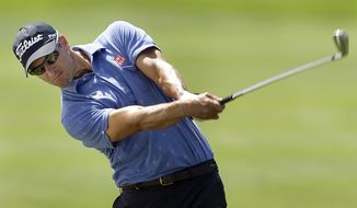 Adam Scott, of Australia, hits from the first fairway during a pro-am before the start of the Arnold Palmer Invitational golf tournament at Bayhill  Wednesday, March 19, 2014, in Orlando, Fla. (AP Photo/Chris O'Meara)
