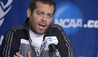 Manhattan coach Steve Masiello speaks during a news conference for the NCAA men's college basketball tournament, Wednesday, March 19, 2014, in Orlando, Fla. Manhattan will play Louisville in a second-round game Thursday. (AP Photo/Phelan Ebenhack)