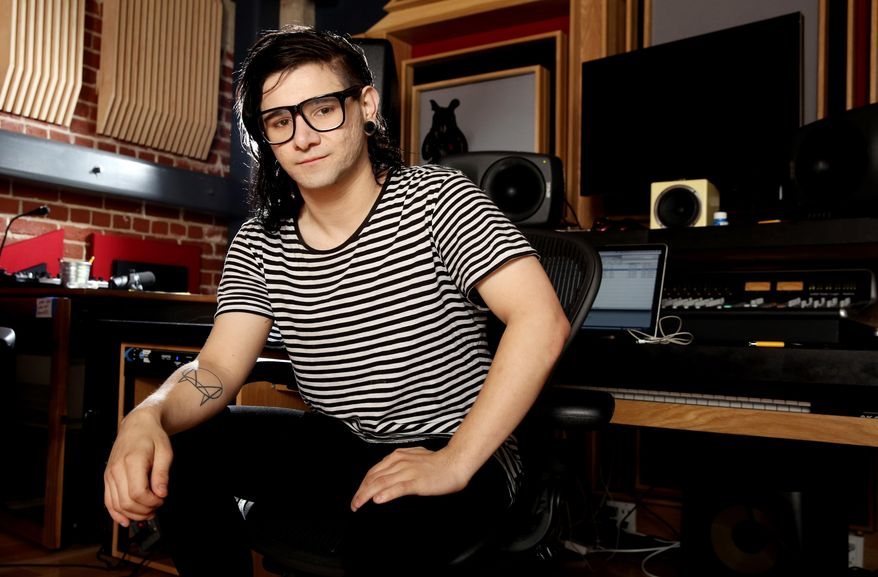 In this Thursday, March 6, 2014 photo, Skrillex, whose real name is Sonny Moore, poses for a portrait in Los Angeles. Skrillex is taking his inspiration from Kanye West these days. The electronic music DJ and producer spent a little time with West, sharing a plane flight from Los Angeles to Las Vegas where each was to perform two years ago, and came away with an invitation to collaborate and an even deeper understanding of the possibilities in front of him. (Photo by Matt Sayles/Invision/AP)