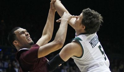 Texas Southern forward Jose Rodriguez, left, and Cal Poly guard Reese Morgan (5) rebound in the first half of a first-round game of the NCAA college basketball tournament on Wednesday, March 19, 2014, in Dayton, Ohio. (AP Photo/Skip Peterson)