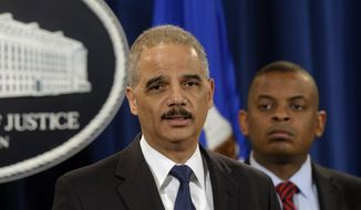 Attorney General Eric Holder, left, accompanied byTransportation Secretary Anthony Foxx, announces a $1.2 billion settlement with Toyota over its disclosure of safety problems, Wednesday, March 19, 2014, during a news conference at the Justice Department in Washington. (AP Photo/Susan Walsh)
