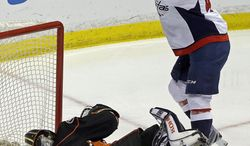 Washington Capitals right winger Joel Ward (42) celebrates his goal over Anaheim Ducks goalie Jonas Hiller (1), of Switzerland, in the first period of an NHL hockey game Tuesday, March 18, 2014. (AP Photo/Reed Saxon)