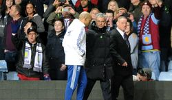 Chelsea manager Jose Mourinho, center right, walks back to dressing rooms after being sent off  during the English Premier League soccer match between Aston Villa and Chelsea at Villa Park, Birmingham, England, Saturday, March 15, 2014.  (AP Photo/Rui Vieira)