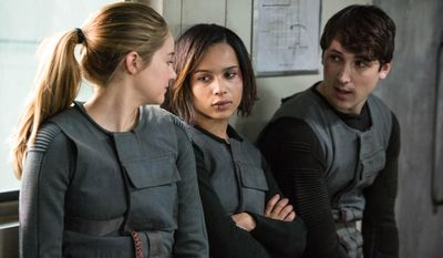 """This photo released by Summit Entertainment, LLC shows, from left, Shailene Woodley as Beatrice """"Tris"""" Prior, Zoe Kravitz, as Christina and Ben Lloyd-Hughes as Will in the film, """"Divergent."""" (AP Photo/Summit Entertainment, Jaap Buitendijk)"""