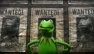 "This image released by Disney shows the muppet character Constantine, a Kermit the frog look-alike, in a scene from ""Muppets Most Wanted."" (AP Photo/Disney Enterprises, Inc., Jay Maidment)"