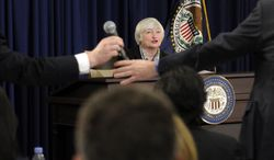 Federal Reserve Chair Janet Yellen speaks during her first news conference at the Federal Reserve in Washington, Wednesday, March 19, 2014. The Federal Reserve is seeking to clarify when it might start to raise short-term interest rates from record lows. The Fed also says it will cut its monthly long-term bond purchases by another $10 billion to $55 billion because it thinks the economy is strong enough to support further improvements in the job market.  (AP Photo/Susan Walsh)