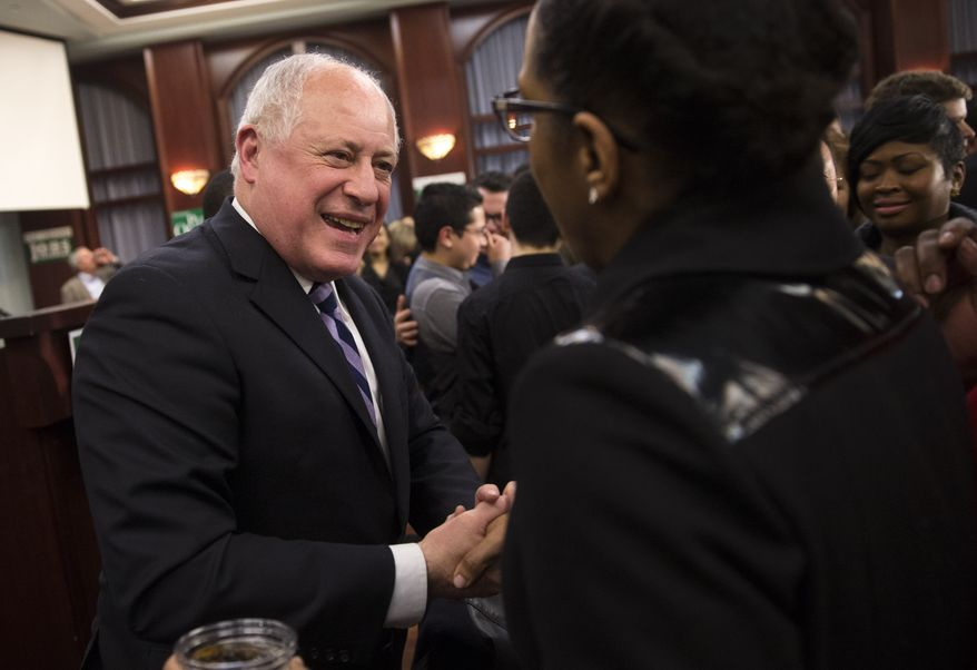 Illinois Gov. Pat Quinn greets guests after declaring his primary election victory during his election night reception on Tuesday, March 18, 2014, in Chicago. (AP Photo/Andrew A. Nelles)
