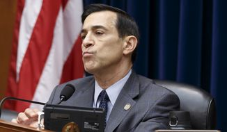 ** FILE ** In this Jan. 16, 2014, file photo, House Oversight Committee Chairman Darrell Issa, R-Calif. is seen on Capitol Hill in Washington. Issa is asking the White House to turn over records related to President Barack Obama's decision to reopen the White House political office earlier this year. Issa says he wants to know if the White House might be using taxpayer money improperly to help Democratic candidates for Congress and other offices.  (AP Photo/J. Scott Applewhite, File)