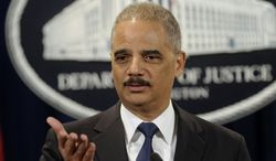 Attorney General Eric Holder announces a $1.2 billion settlement with Toyota over its disclosure of safety problems, Wednesday, March 19, 2014, during a news conference at the Justice Department in Washington. (AP Photo/Susan Walsh)