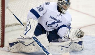 Tampa Bay Lightning goalie Ben Bishop makes a save against the Ottawa Senators during the first period of an NHL hockey game Thursday, March 20, 2014, in Ottawa. (AP Photo/The Canadian Press, Adrian Wyld)