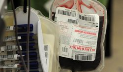 ** FILE ** Blood is collected in St. Cloud Minn., March 19, 2014.  (AP Photo/The St. Cloud Times, Dave Schwarz)