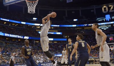 Colorado forward Xavier Johnson (2) dunks the ball during the second half in a second-round game in the NCAA college basketball tournament Thursday, March 20, 2014, in Orlando, Fla. (AP Photo/Phelan M. Ebenhack)