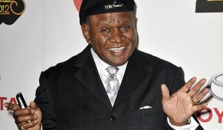 FILE - In this Nov. 8, 2012 file photo, actor and comedian George Wallace arrives at the Soul Train Awards in Las Vegas. Wallace is in a Las Vegas courtroom this week, seeking damages from a Las Vegas resort and a credit card company he blames for a leg injury he received when he tripped over electrical wiring during a private performance in December 2007. (Photo by Jeff Bottari/Invision/AP,File)