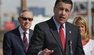** FILE ** Nevada Gov. Brian Sandoval  speaks during a news conference, Thursday, March 20, 2014, in Las Vegas. (AP Photo/Julie Jacobson)
