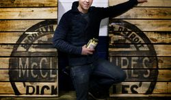 ADVANCE FOR MONDAY, MARCH 24 - In this photo taken on March 4, 2014, Joe McClure, co-owner of McClure's Pickles poses for a photograph at his warehouse in Detroit. (AP Photo/Detroit Free Press, Kimberly P. Mitchell)  DETROIT NEWS OUT;  NO SALES, TV OUT. MANDATORY CREDIT
