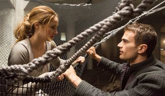 "Shailene Woodley, left, stars as Beatrice, with Theo James as her trainer, Four, in ""Divergent."" (Summit Entertainment/Associated Press)"