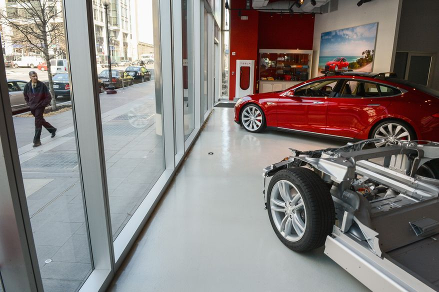 """In states that have banned the sale of automobiles directly from the manufacturer, Tesla is transforming its stores into galleries and operating with a """"look, but don't touch"""" policy. (Andrew Harnik/The Washington Times)"""