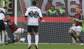 Parma forward Antonio Cassano, left, scores during a Serie A soccer match between AC Milan and Parma, at the San Siro stadium in Milan, Italy, Sunday, March 16, 2014. (AP Photo/Luca Bruno)