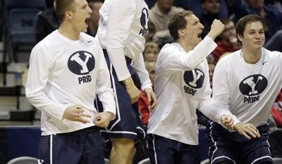 BYU bench react after BYU guard Tyler Haws (3) scores a three pointer during the second half of a second-round game against the Oregon in the NCAA college basketball tournament Thursday, March 20, 2014, in Milwaukee. (AP Photo/Jeffrey Phelps)
