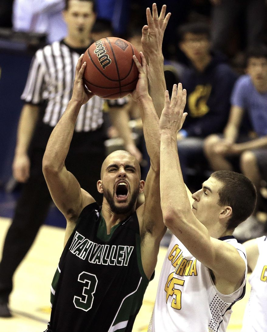 Utah Valley's Keawe Enos (3) drives the ball against California's David Kravish, right, in the second half of an NCAA college basketball game in the NIT tournament, Wednesday, March 19, 2014, in Berkeley, Calif. (AP