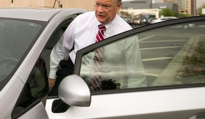 FILE - Former Fiesta Bowl executive director John Junker gets into his car outside the Sandra Day O'Connor U.S. courthouse after being sentenced in Phoenix on in this March 13,  2014 file photo. The sentencing Thursday March 20, 2014 of 58-year-old John Junker in Maricopa County Superior Court will mark the end of criminal cases that arose from the contribution scandal that jeopardized the bowl's NCAA license and led to the ouster of the longtime bowl leader. (AP Photo/The Arizona Republic, Michael Schennum, File)  MARICOPA COUNTY OUT; MAGS OUT; NO SALES