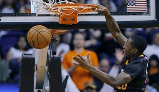 Phoenix Suns' Archie Goodwin dunks against the Orlando Magic during the first half of an NBA basketball game, Wednesday, March 19, 2014, in Phoenix. (AP Photo/Matt York)