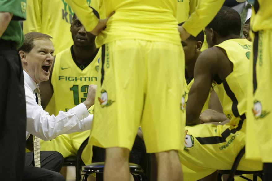 Oregon head coach Dana Altman talks to his team during a timeout during the second half of a second-round game against the BYU in the NCAA college basketball tournament Thursday, March 20, 2014, in Milwaukee. Oregon won 87-68. (AP Photo/Morry Gash)