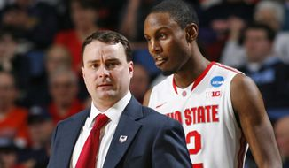 Dayton head coach Archie Miller, left, and Jalen Robinson, right, react during the second half of a second-round game against Ohio State in the NCAA college basketball tournament in Buffalo, N.Y., Thursday, March 20, 2014. Dayton won the game 60-59. (AP Photo/Bill Wippert)