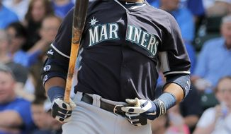Seattle Mariners' Robinson Cano looks at his bat during the first inning of a spring training baseball game against the Chicago Cubs Thursday, March 20, 2014, in Mesa, Ariz. (AP Photo/Matt York)